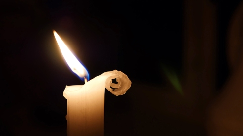 Candle flame in light breeze, wind, wax curling right side, cute